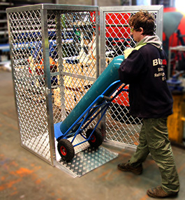 Gas cylinders into cage using ramp