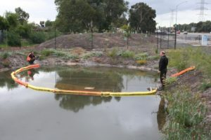Oil and fuel spill boom on water